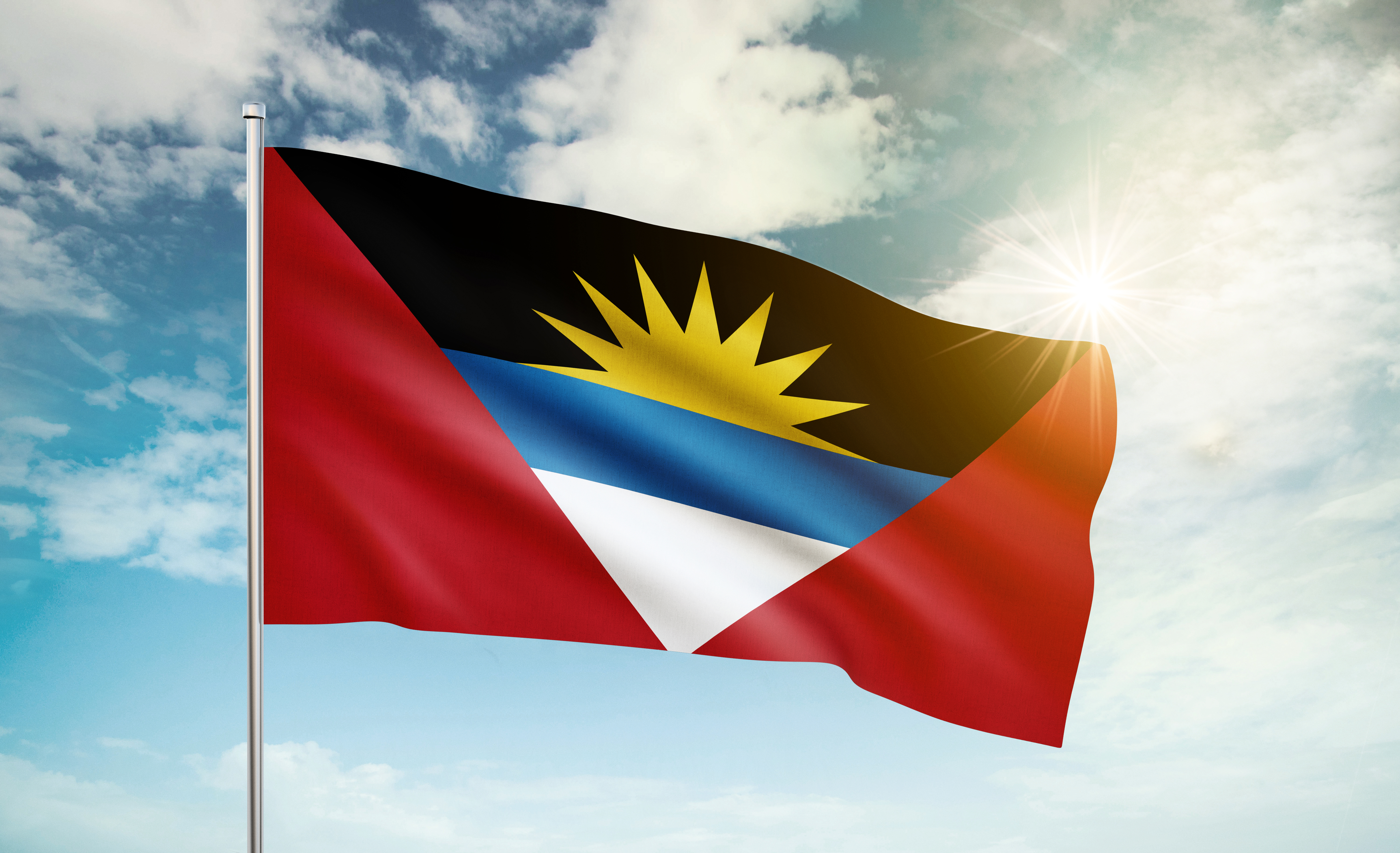 Flag of Antigua and Barbuda, which symbolizes the citizenship of the Caribbean islands