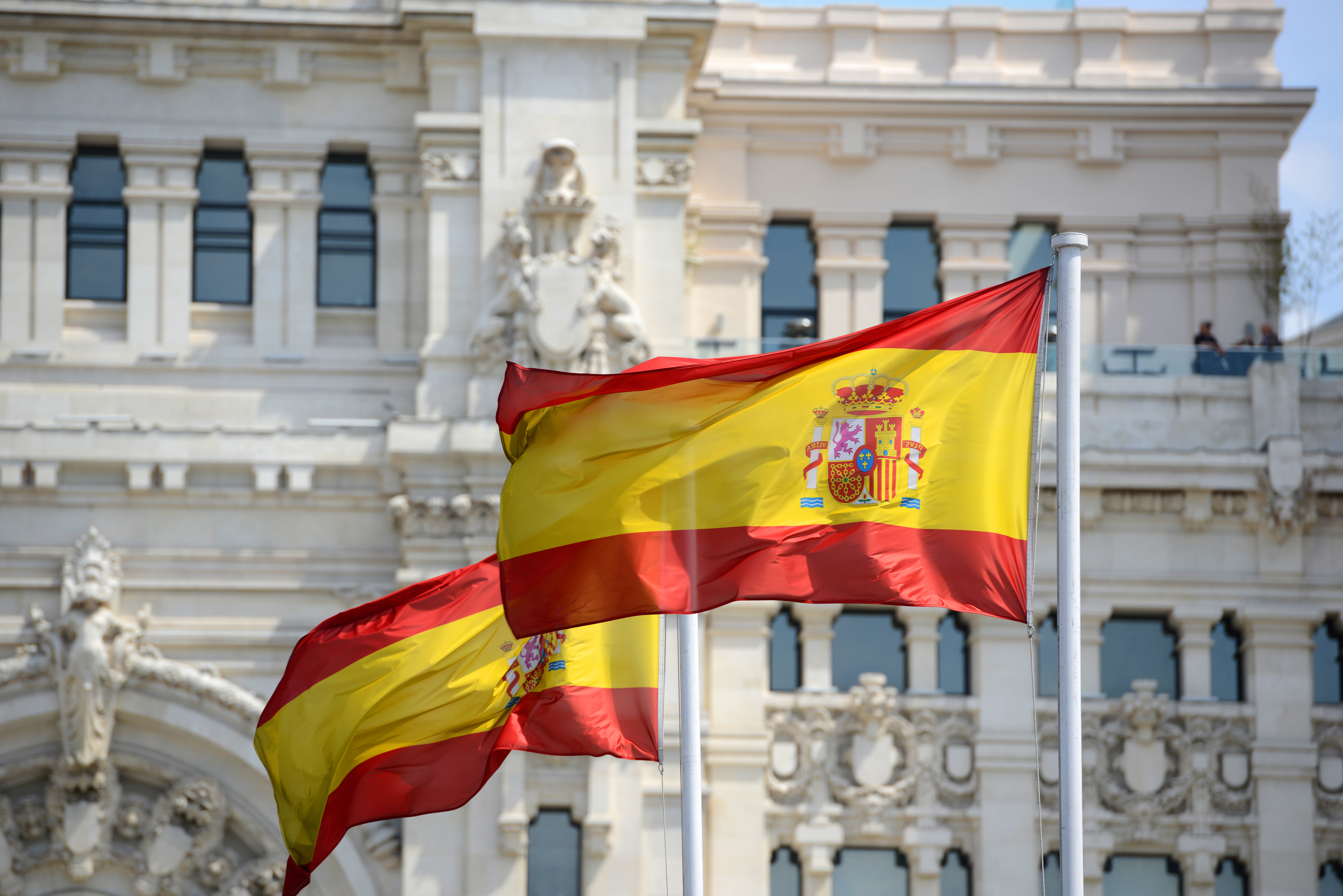 The Spanish flag symbolizes a residence permit in Spain by investment